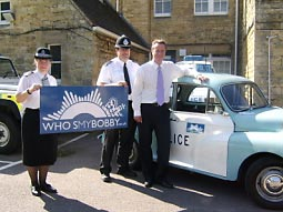 MP for Witney, David Cameron, with 'Bobby', PC Reg Nicolson and Liz Mitchell  at the launch which included a stop at  Chipping Norton police station